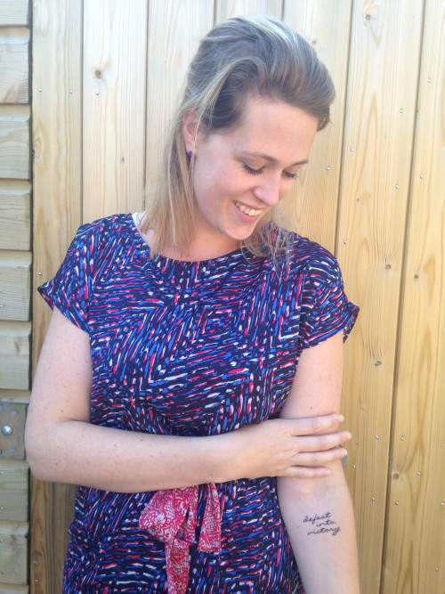 7 augustus 2015: ik liet mijn tattoo zetten 'defeat into victory'